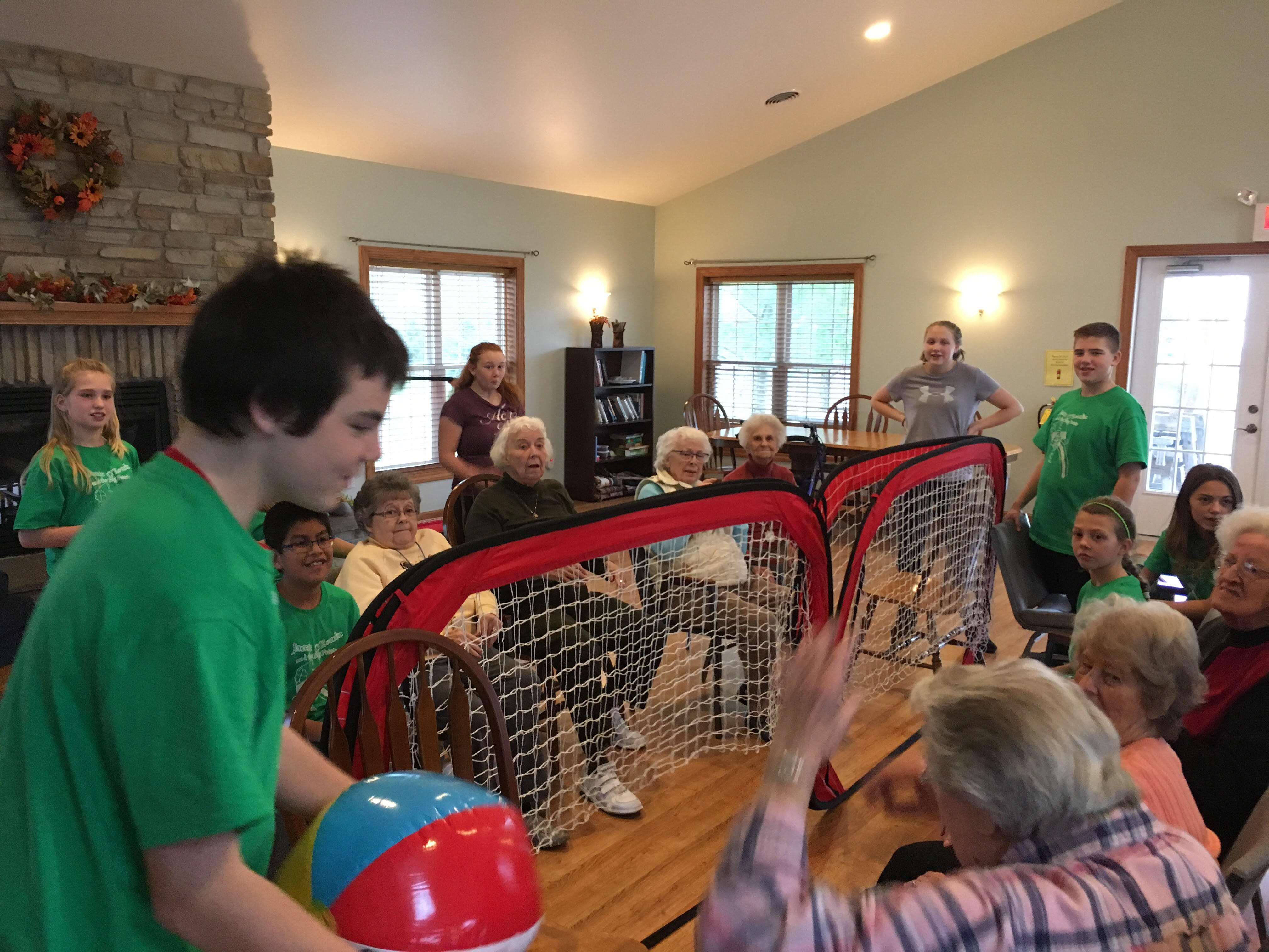 Seventh grade physical education students play ball with Cedar Landing residents