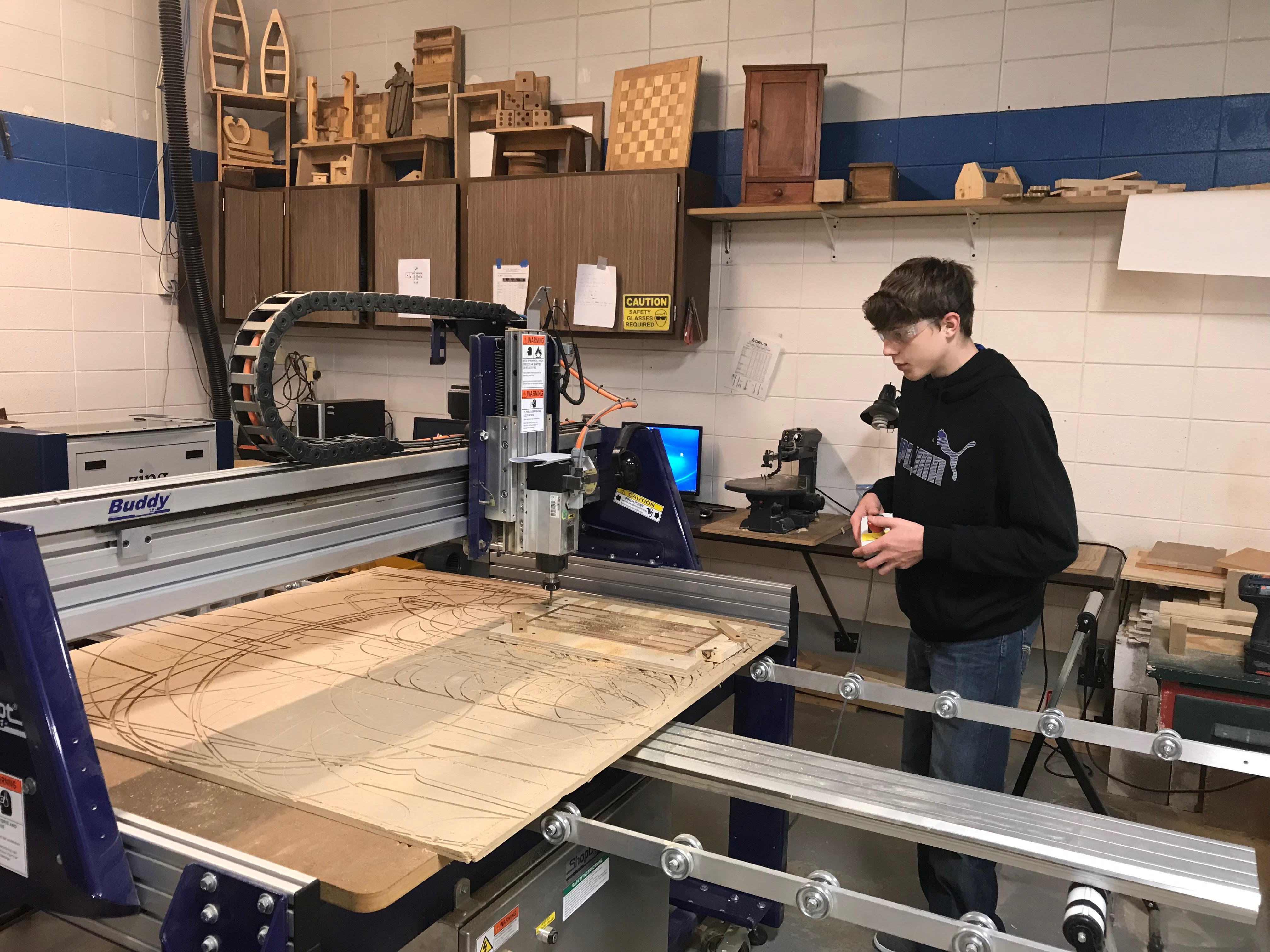 Student working in metals class